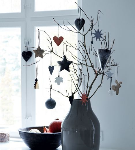 ornaments hanging on garden branches christmas decorations in the monochrome danish home of nordstjerne owner henriette bach with christmas touches