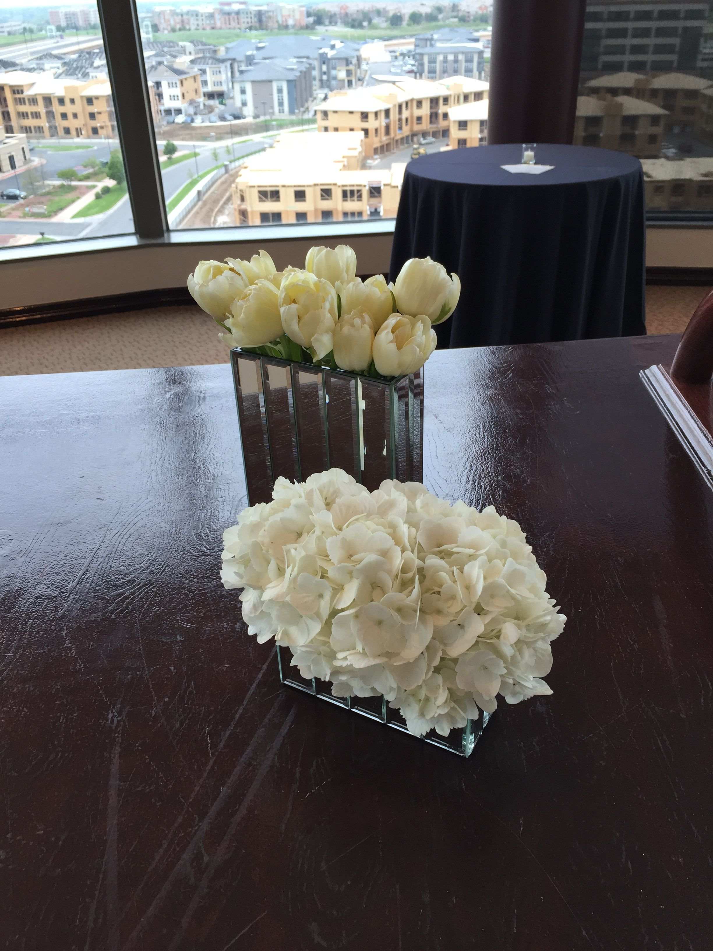 option for elegant mirrored vases to use for lesser expensive lining of the tables.  photo to show how the white hydrangea will look in them.