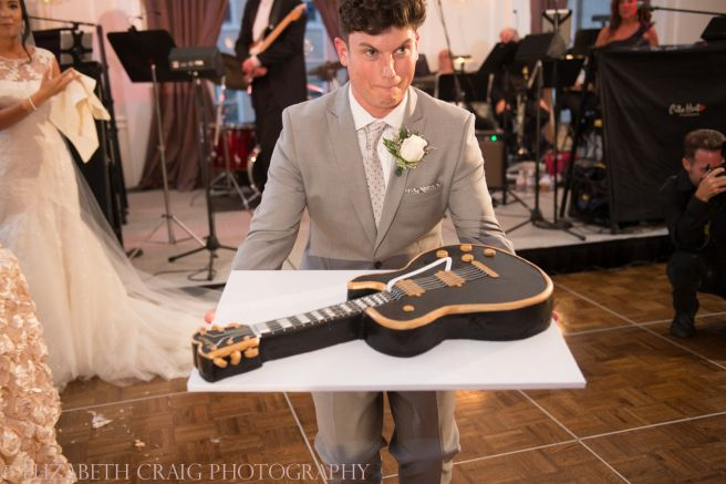 What groom won't want this for his cake? The bride surprised her groom with a special cake, a replica of a Les Paul guitar. A highlight of the night, along with City Heat band performing all their favorite songs at the University Club in Pittsburgh! // johnparkerbands.com
