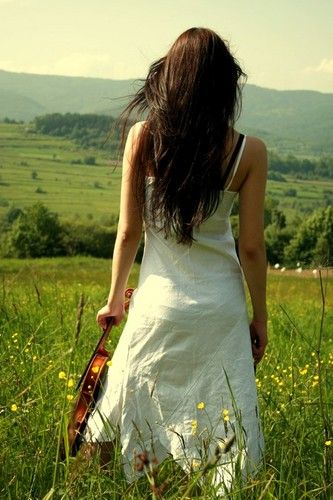 girl in nature holding violin