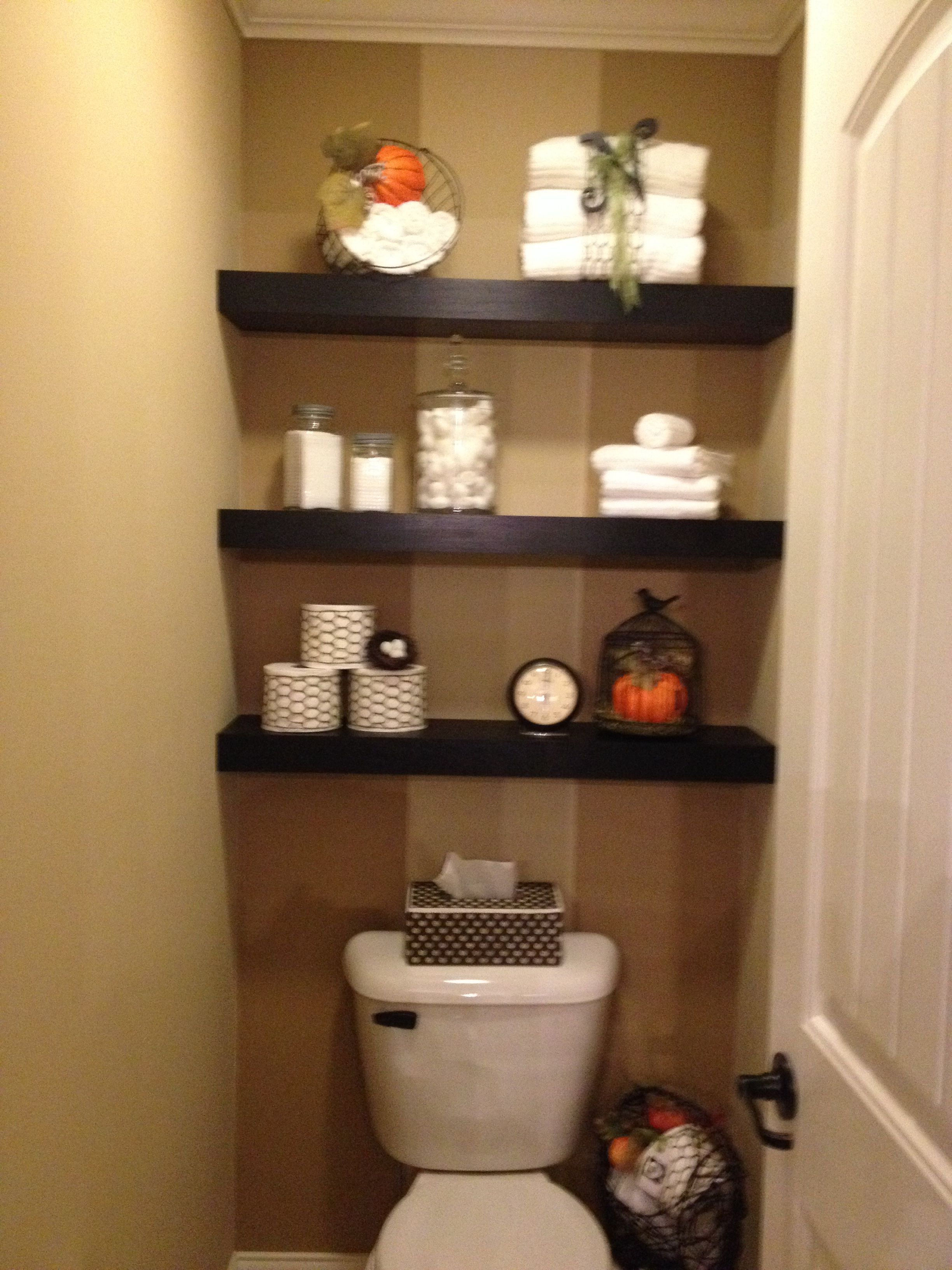 Floating shelves decorated for fall