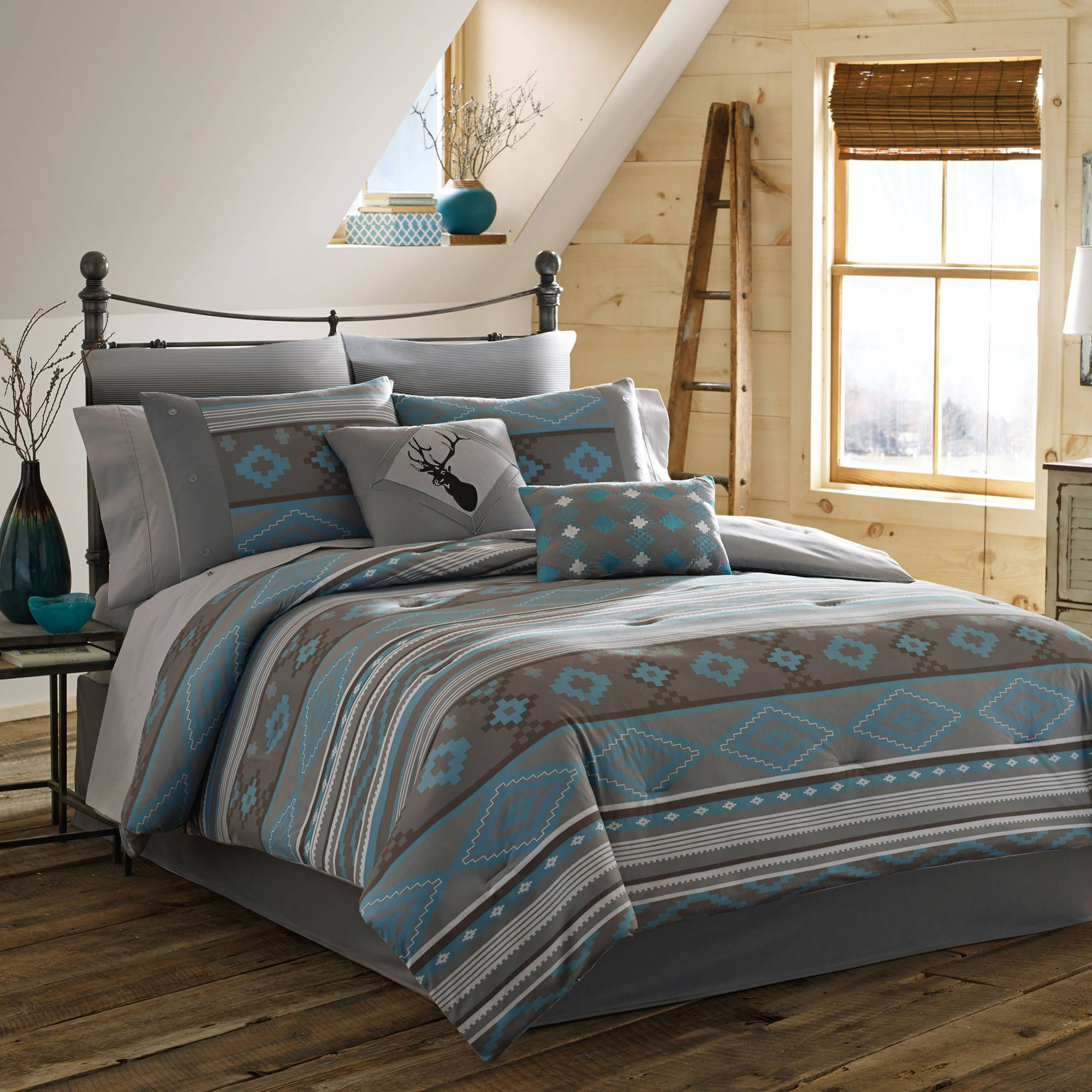 Grey Stripped Pillow On Teal Grey Bedding Of A Welcome Comfort