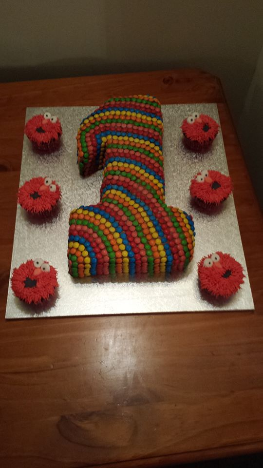 number 1 cake decorated with mini MMs with elmo cupcakes Cupcake