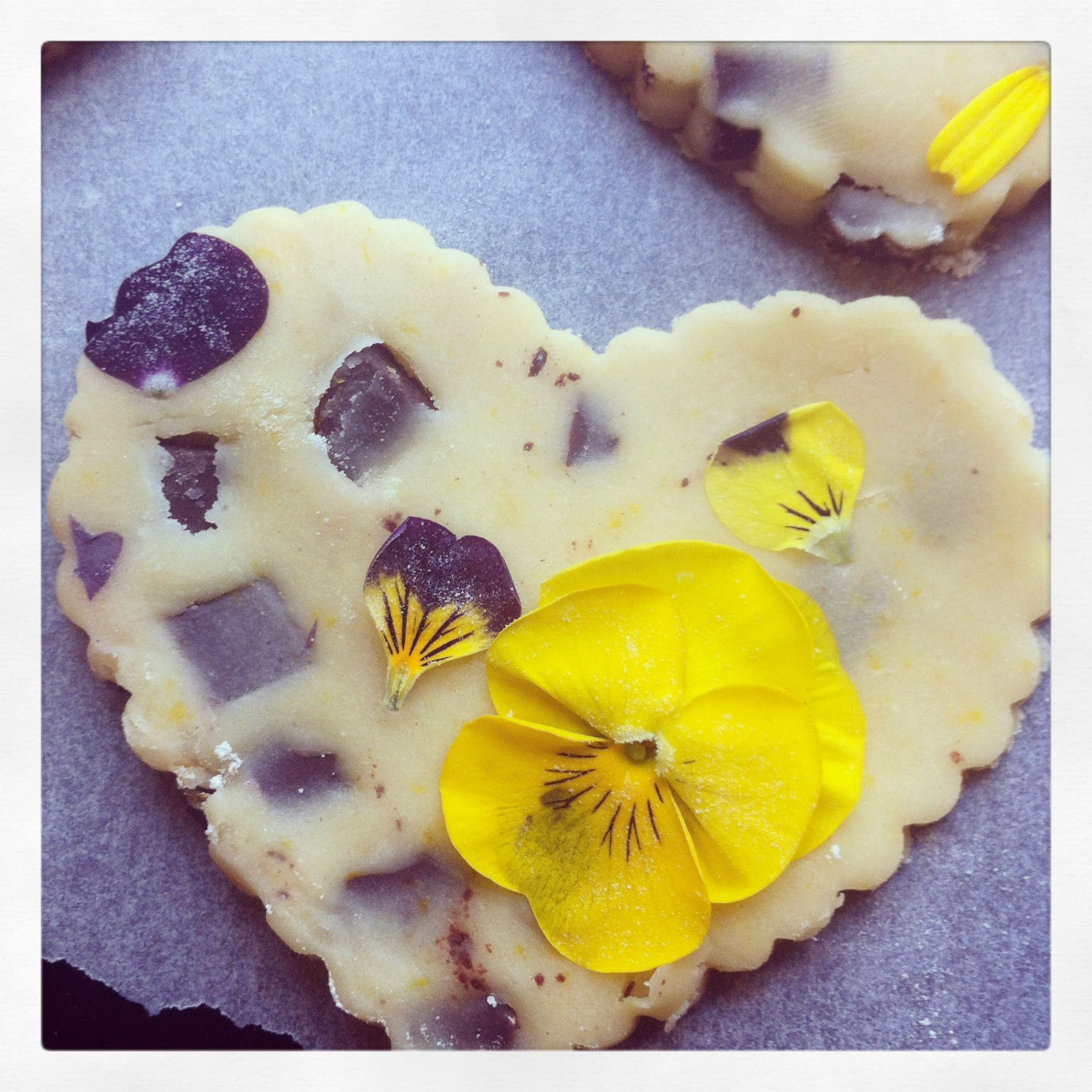 chocolate chip and orange cookie dough cut outs for valentines day with edible flowers from greensofdevon.com