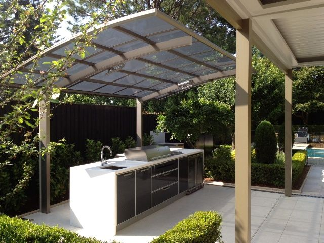 A cantaport shade structure used to protect an outdoor bbq for Outdoor kitchen roof structures