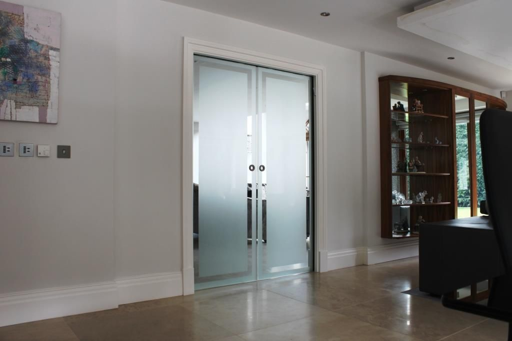 Glass Pocket Doors Installed Into A Private House Leeds. The System Uses  10mm Etched Glass