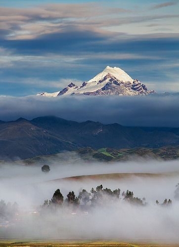 """""""Andes Ambience"""" - A snowcapped mountain catches the first rays of light during a misty morning on the Chinchero Plateau, Cusco, Peru. Photo by Jon Reid"""