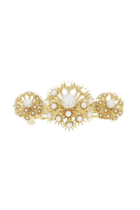 See the totally adult design (and price tag) on this one? It's just begging for a low chignon and something backless. Rosantica Soffioni gold-dipped pearl hair clip, $325; net-a-porter.com
