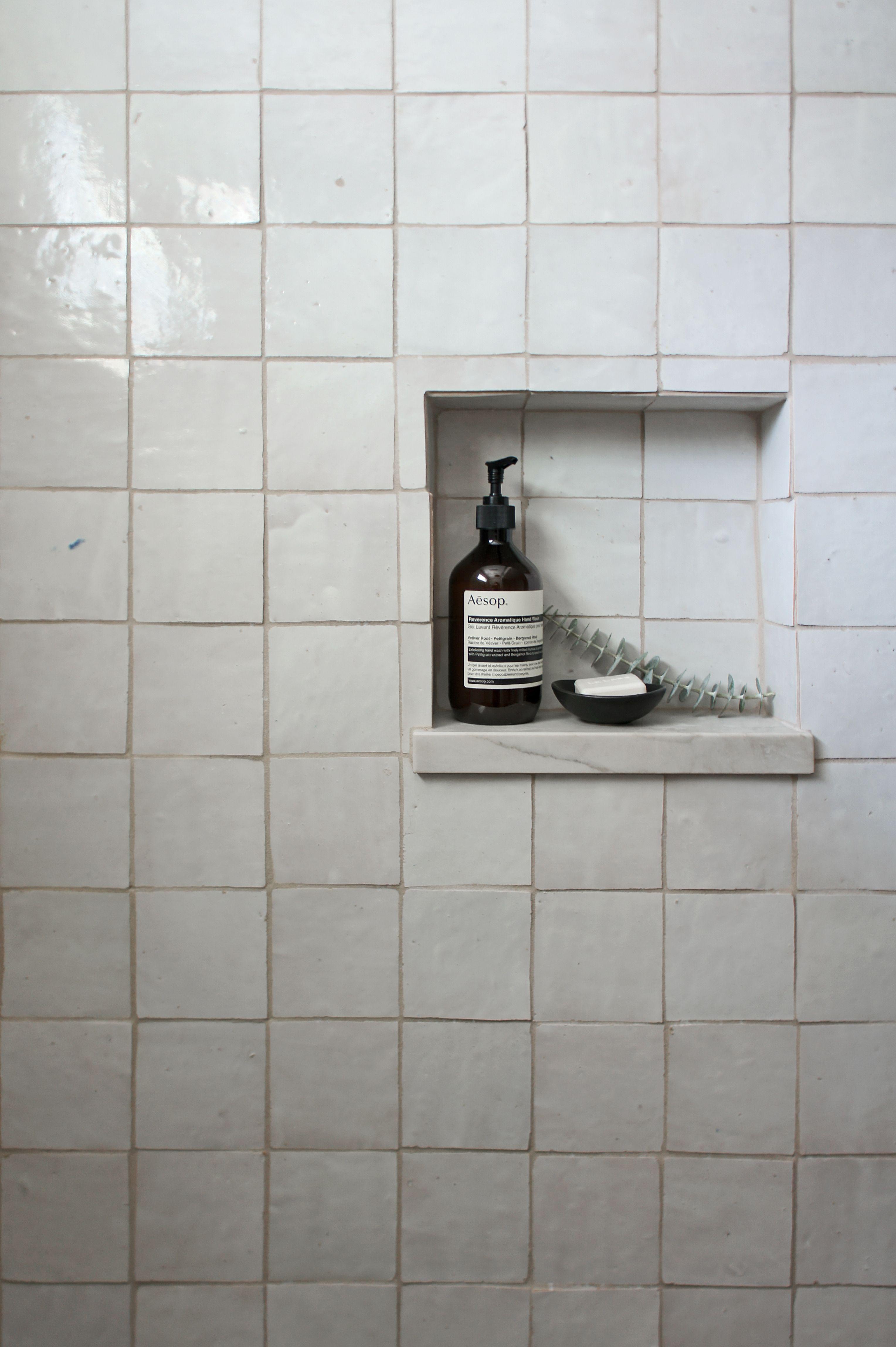 earthy bathroom zellige tile shower niche