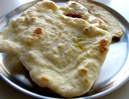 My favorite bread as a little girl a neighbor mom made these by the naan on tawa or tawa naan recipe easy step by step recipe to make tawa naan on the stove top on an regular pan called tawa in india forumfinder Gallery