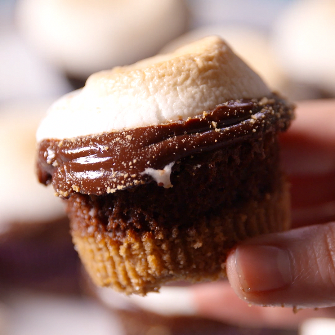 S'mores are the best. There's no denying it. And now you can have everything you love about s'mores - buttery graham crackers, melty chocolate, and toasted marshmallow - in a cupcake! It's the best of both worlds!! Get the recipe at .
