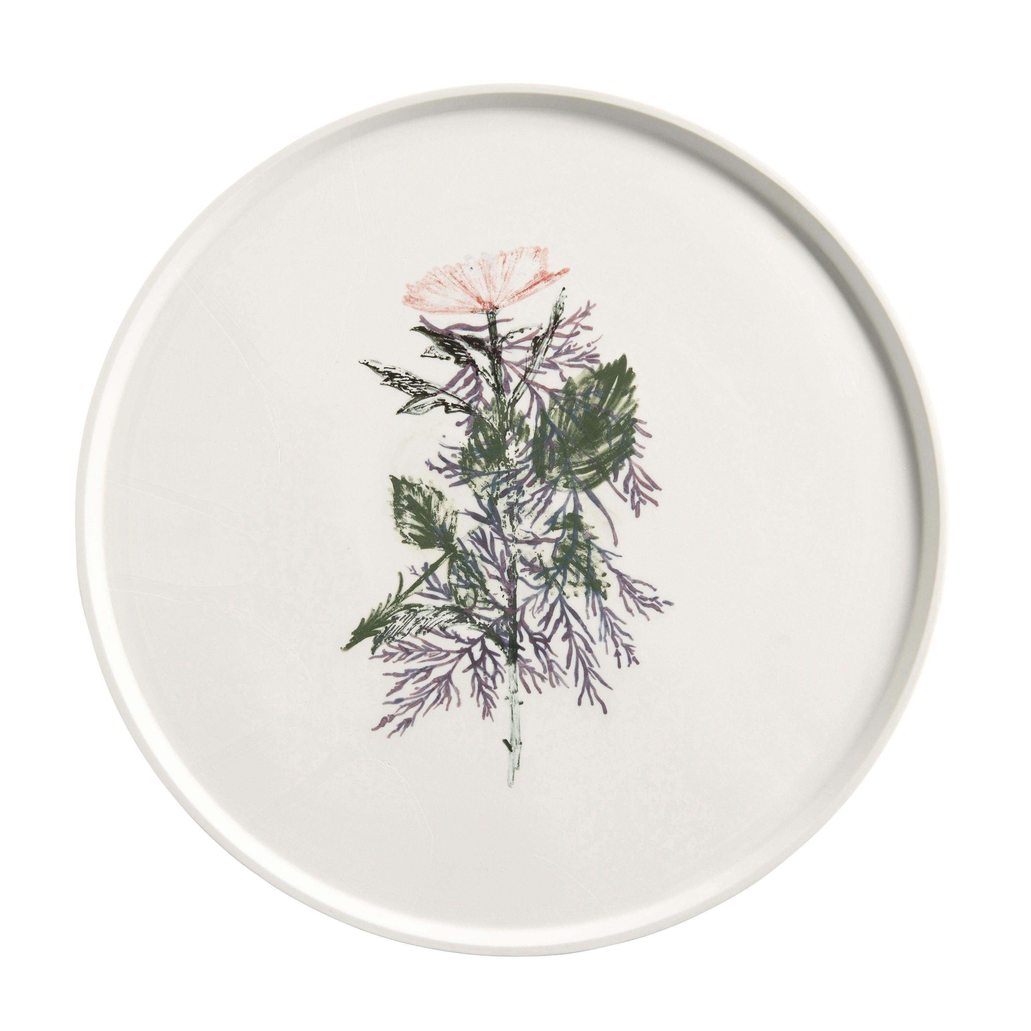 Met ingebakken bloem: schaal uit de Withering Tableware-collectie van Studio Maarten Kolk en Guus Kusters. € 290,-, www.wannekes.nl