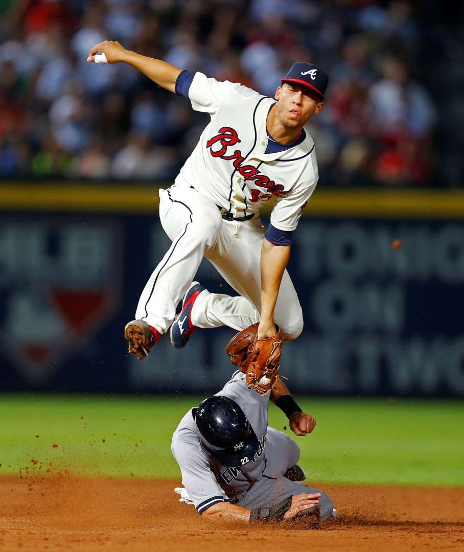 Jumping Tag New York Yankees Jacoby Ellsbury Is Tagged Out By Atlanta Braves Shortstop Andrelton Simmons As He Tries To Steal Second Base In The F