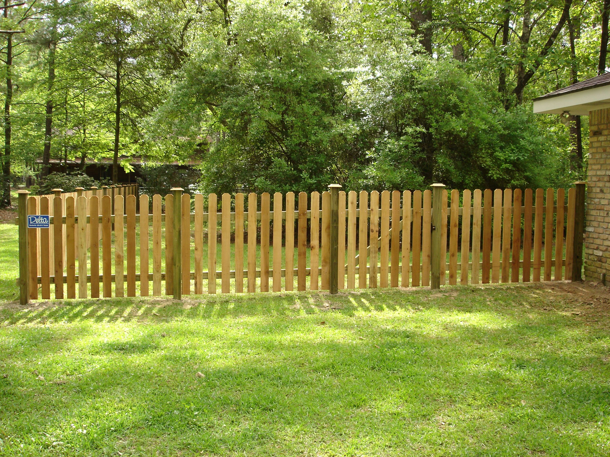 dogear pickets with visible posts with post caps cedar fence