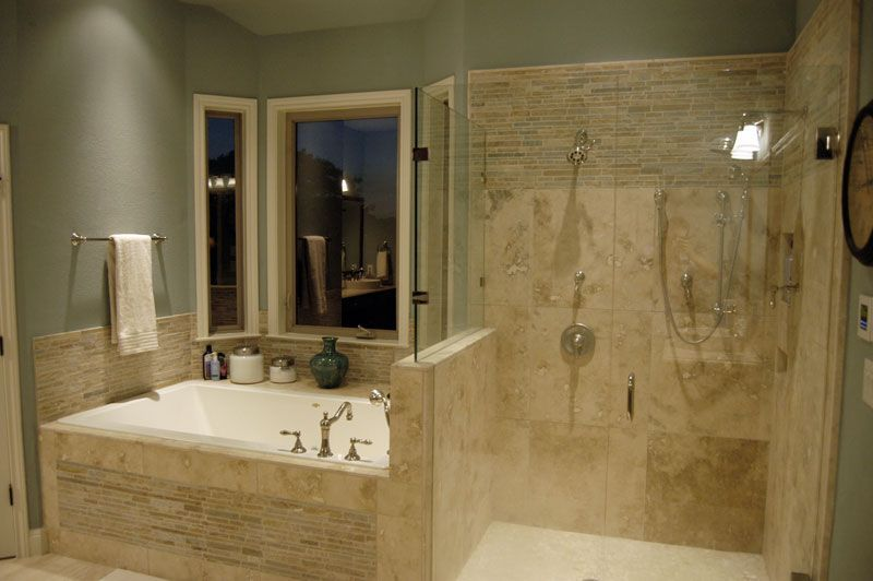 The tile walls add a textured look to this bathroom with walk-in shower.