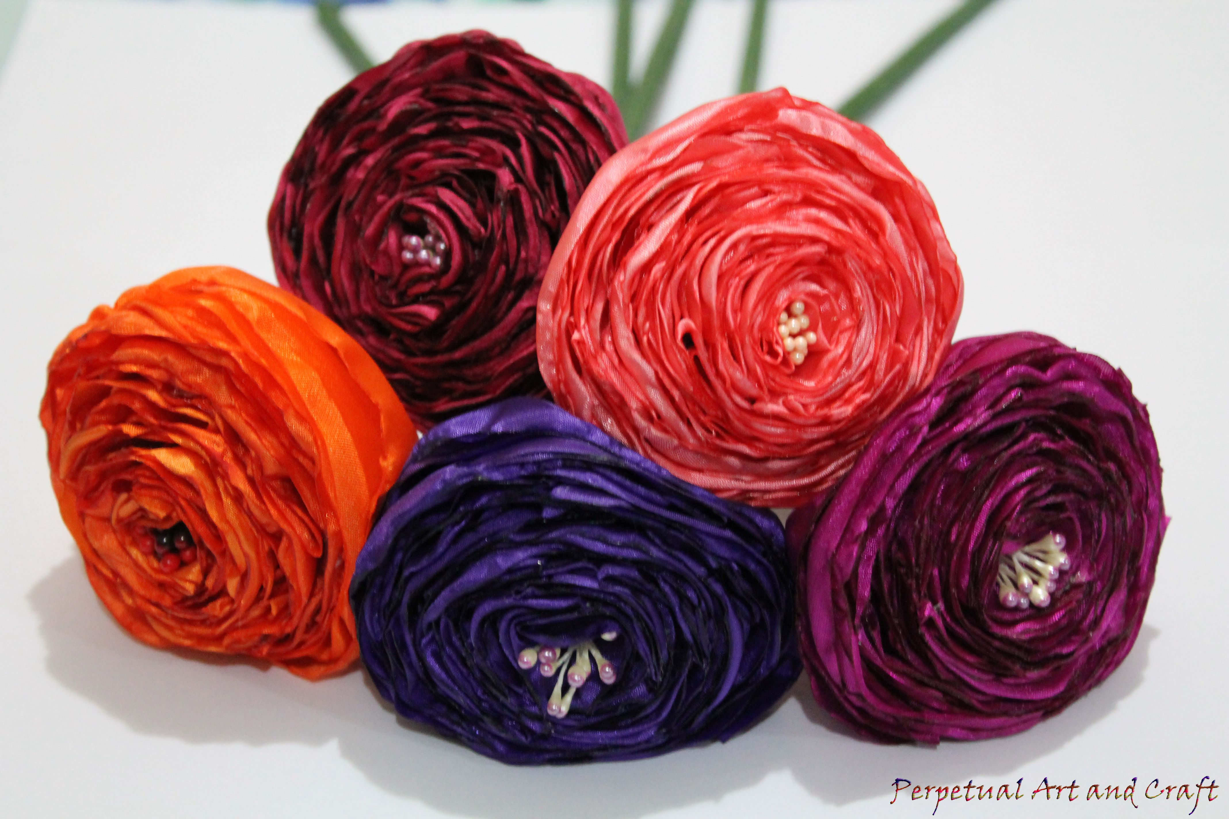 Rolled rosettes handcrafted with silk fabric