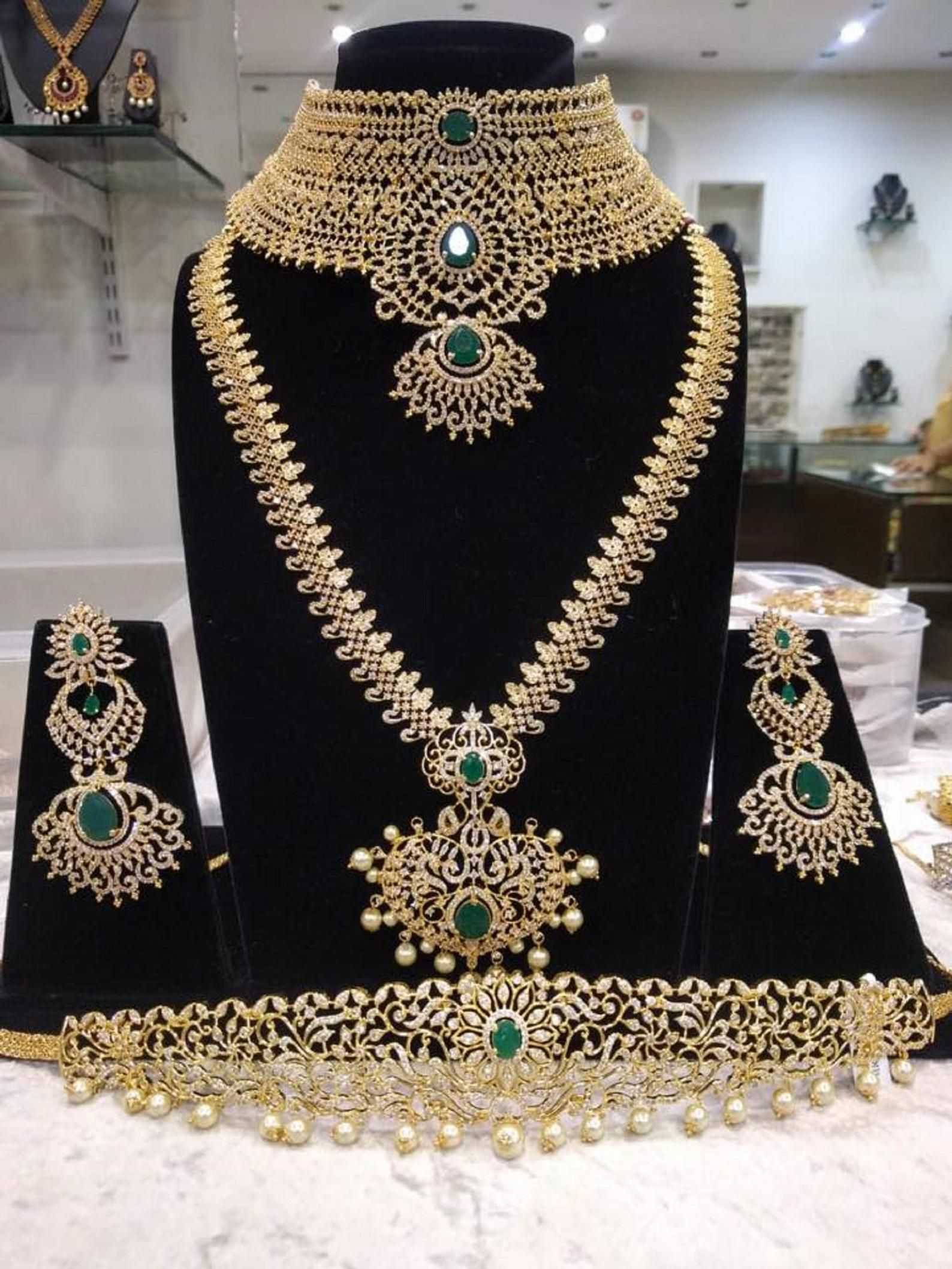 263590aa62 The Grand Bridal Set with a Long Necklace,Collar Choker Necklace,Earrings &  Waist Belt/Vaddanam in American Diamonds and Emeralds(1gm Gold)