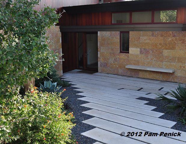 Poured-concrete slabs with Texas Black gravel | Garden Paths