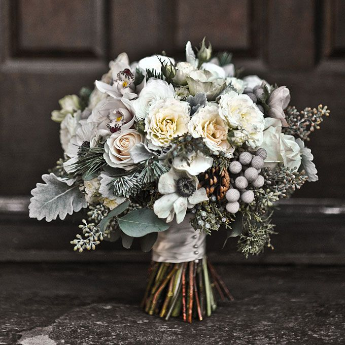 Winter Wedding Bouquet Of Mini Cymbidium Orchids Silver Brunia Juniper Pine Boughs Anemones Cones Garden Spray Roses Seeded Eucalyptus