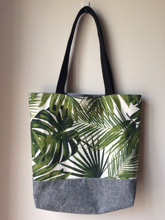 d410471c6 This tote bag features tropical leaves with a grey chambray fabric. Use it  as your