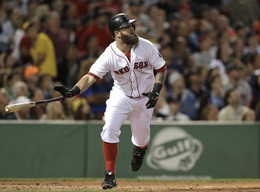 Boston Red Sox's Mike Napoli watches the flight of his two-run home run off a pitch by New York Yankees' Ivan Nova in the first inning of a ...
