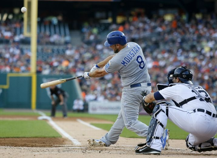 DETROIT, MI - JUNE 17: Mike Moustakas #8 of the Kansas City Royals hits a two-run home run as Alex Avila #13 of the Detroit Tigers works behind the plate during the second inning at Comerica Park on June 17, 2014 in Detroit, Michigan. (Photo by Duane Burleson/Getty Images)