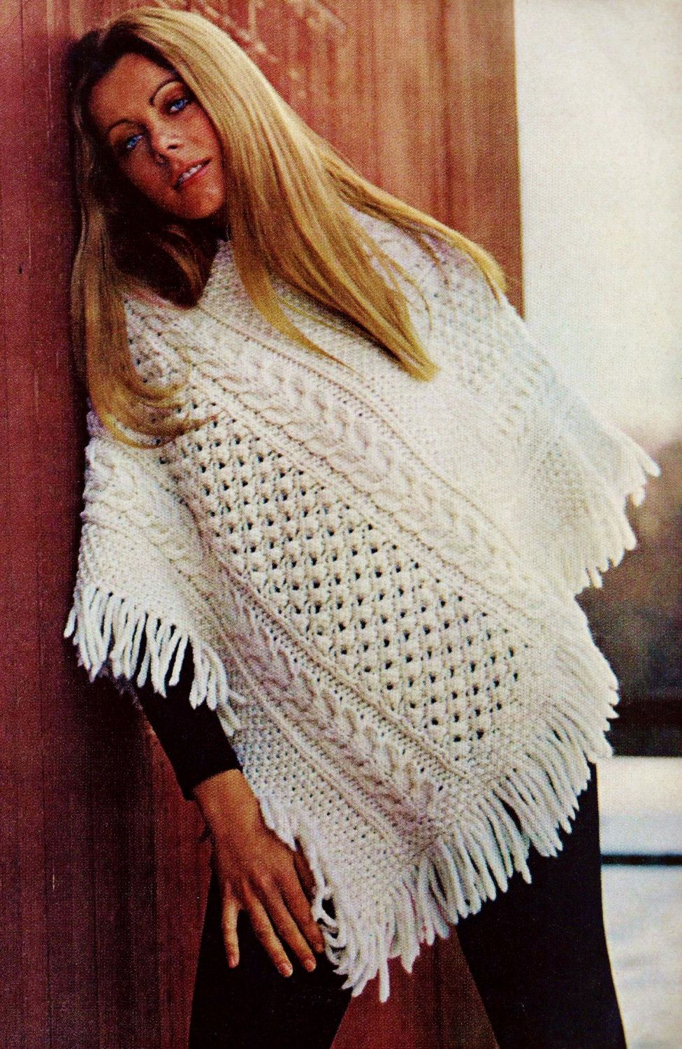 Knitting an Irish-style sweater with a pattern. Detailed diagram with photo and description for beginners