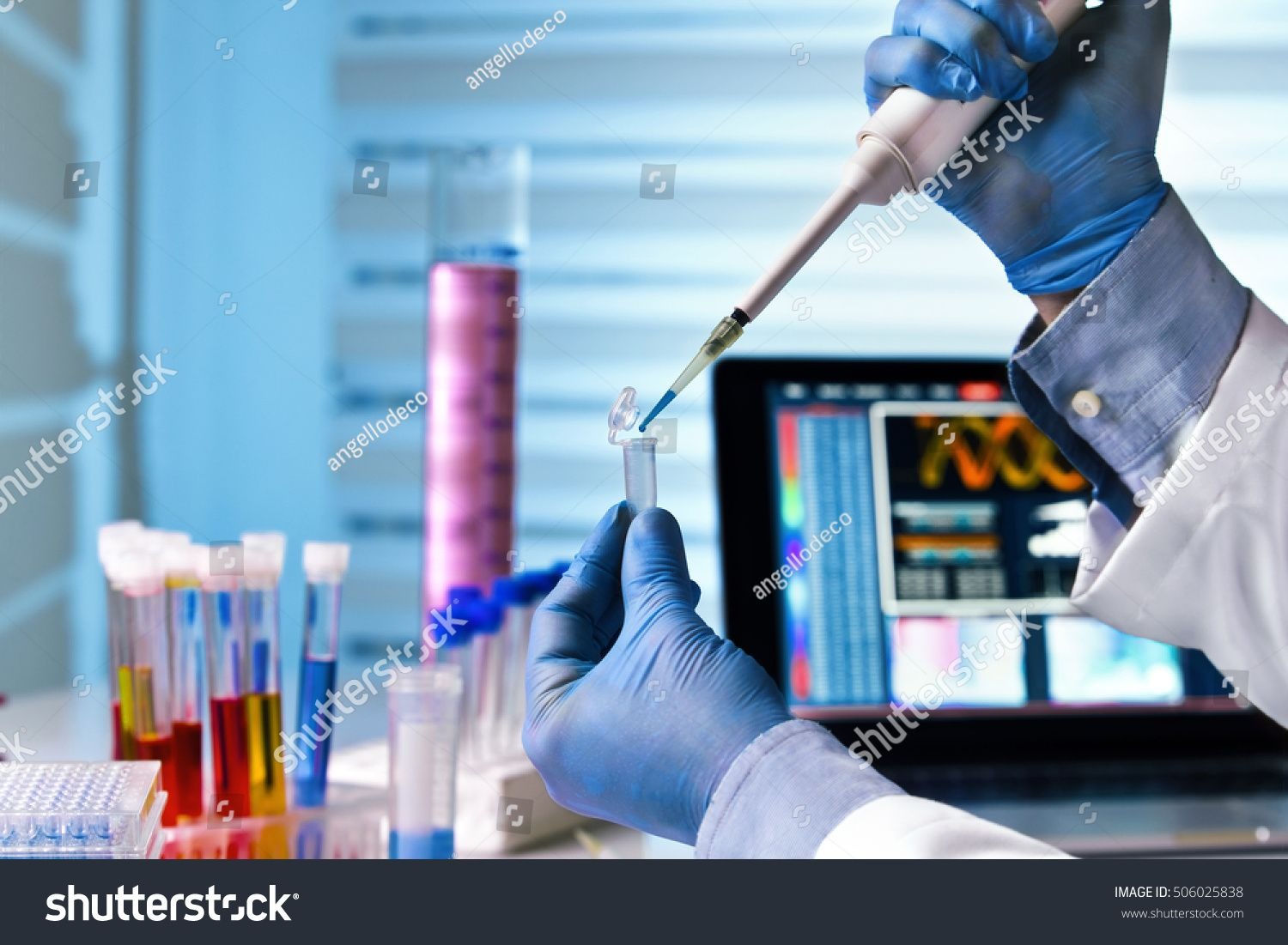 Scientist Holding Tube And Working With Laptop At Genetic Lab U002f Hands Of Engineer Genetic Working In Laborat Biomedical Chemical Engineering Homework Help [ 1101 x 1500 Pixel ]