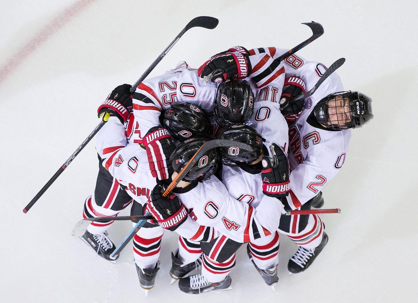 UNO 2, New Hampshire 1, OT: UNO's Jake Randolph and Tyler Vesel celebrate with the team after Randolph scored with a Vesel assist in the third period on Dec. 30, 2014. By: MARK DAVIS/THE WORLD-HERALD