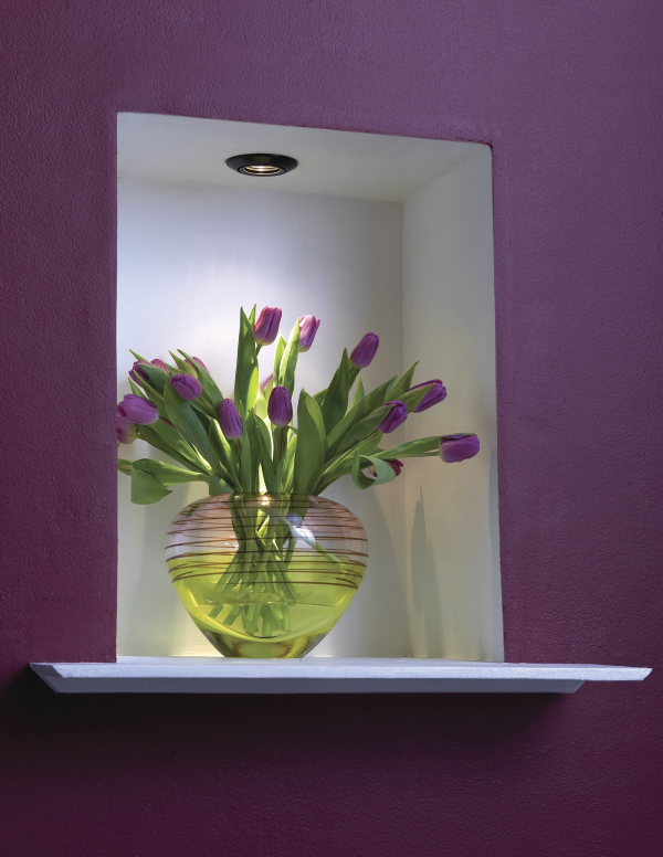 Single recessed light above accents this piece.
