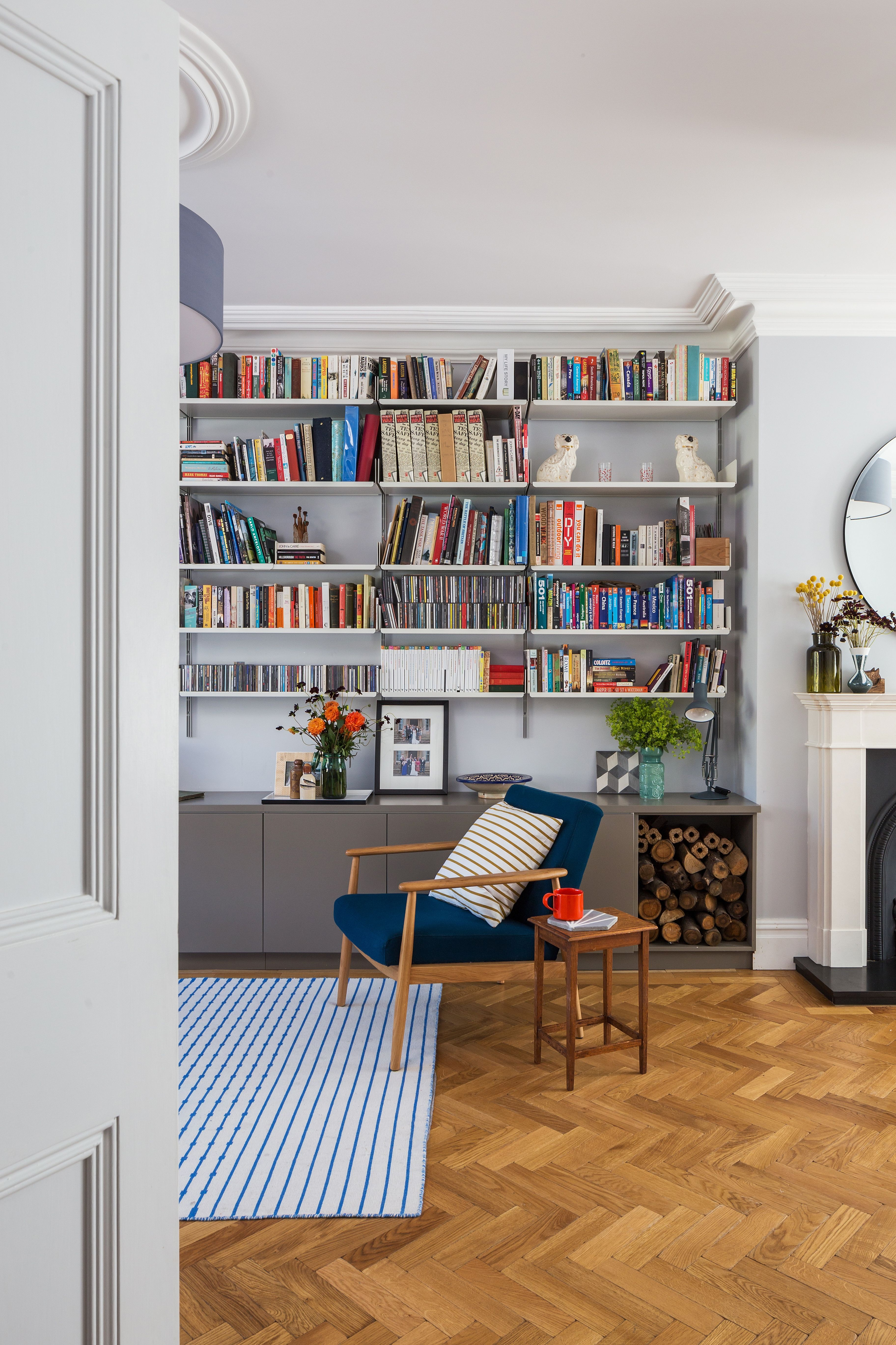 Interior design by Imperfect Interiors at this lovely Double Fronted Victorian house in East Dulwich London Oak parquet flooring mid century chairs and open shelving in the open plan living room graphy Ignas Jermosenka