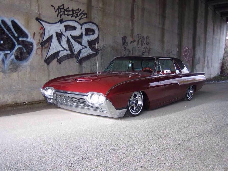 ford thunderbird laid out on narrow white wall tires and five spoke wheels and dressed