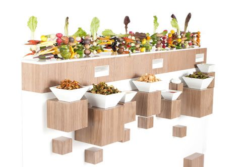 From Pinch Food Design - This hedge is only six inches deep, like a table on it's side. It's fun to watch guests come from different sides of the party and graze together over food.