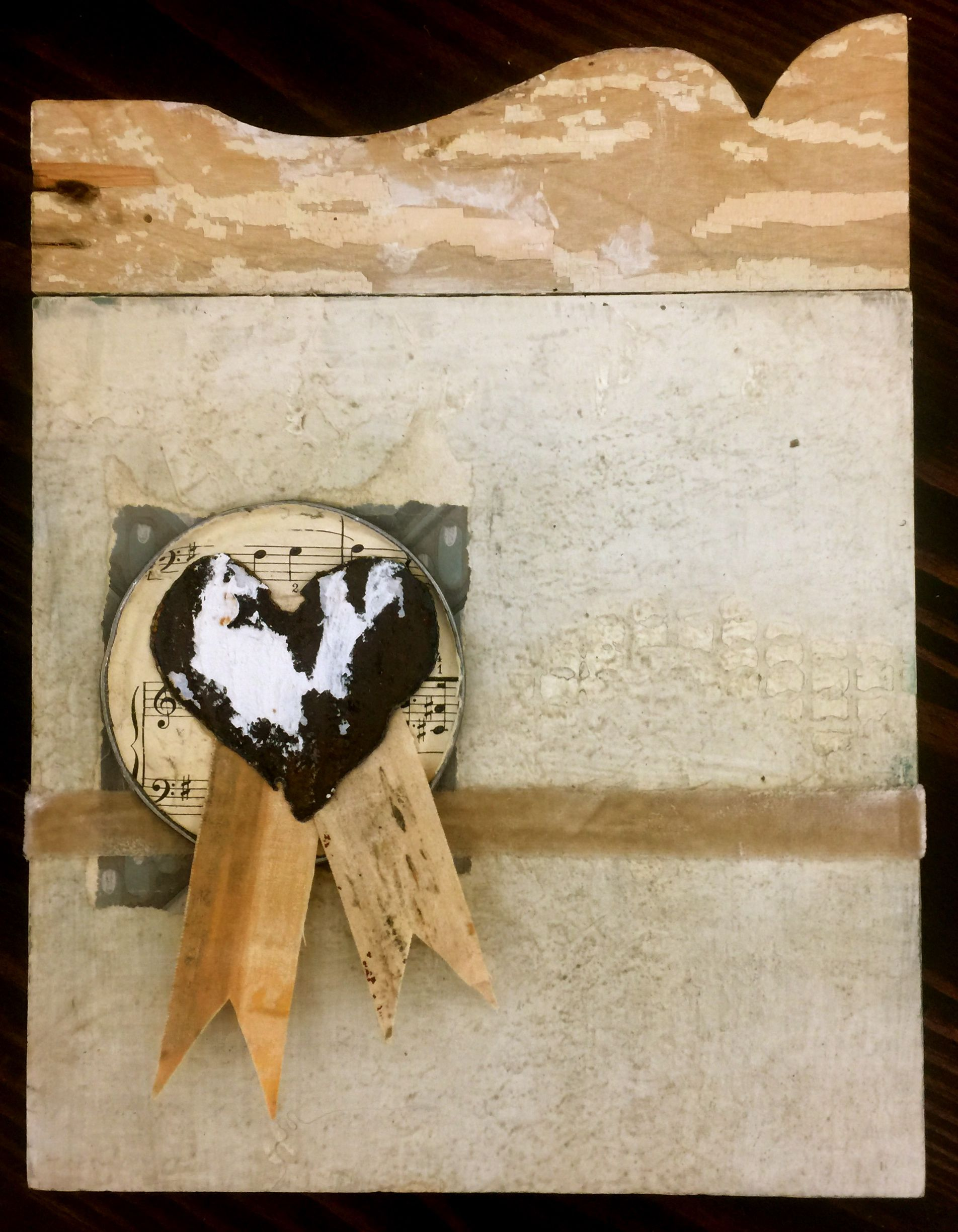 Mixed media heart with salvaged materials