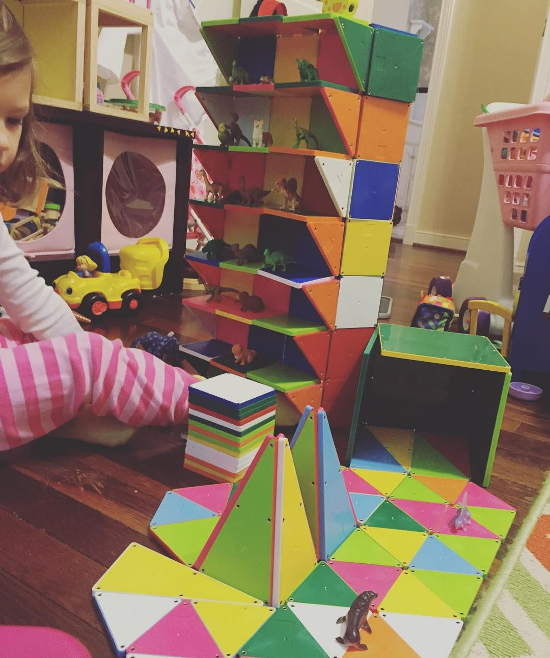 We made a Magna-Tiles apartment building, complete with a garden- for her little animal figures.