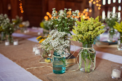 Multiple jars filled with one type of flower each.