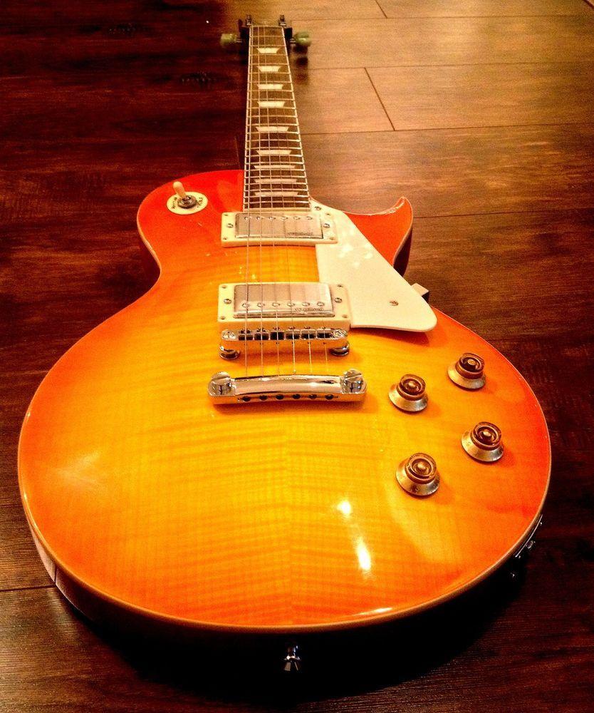 New Vintage V100hb Honeyburst Flame Top Lp Guitar Case Available Vintageguitars Lespaul Guitar Case Guitar Vintage V100