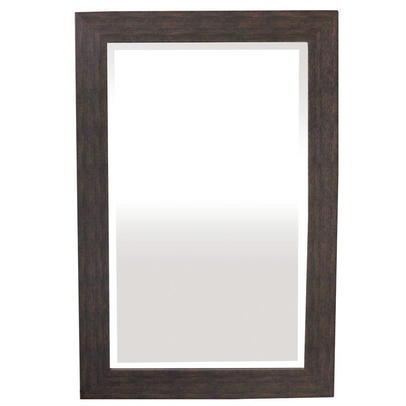 Adorn your home with this beautiful mirror that also serves as a lovely wall ornament. The glass glistens while the frame displays an espresso color that will compliment any living space. Take this piece of decor home to enjoy today.