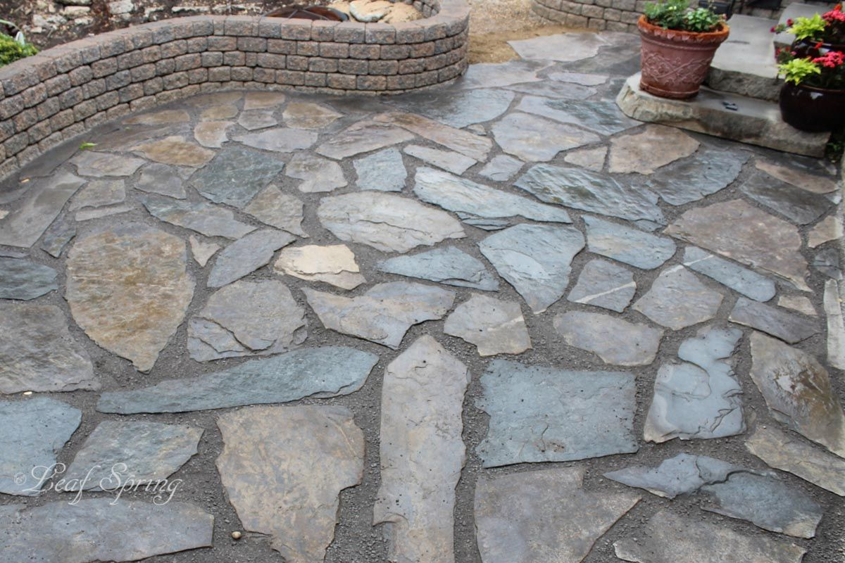 Filler For Stone Patio : Brown rundle rock patio with grey crushed limestone fill