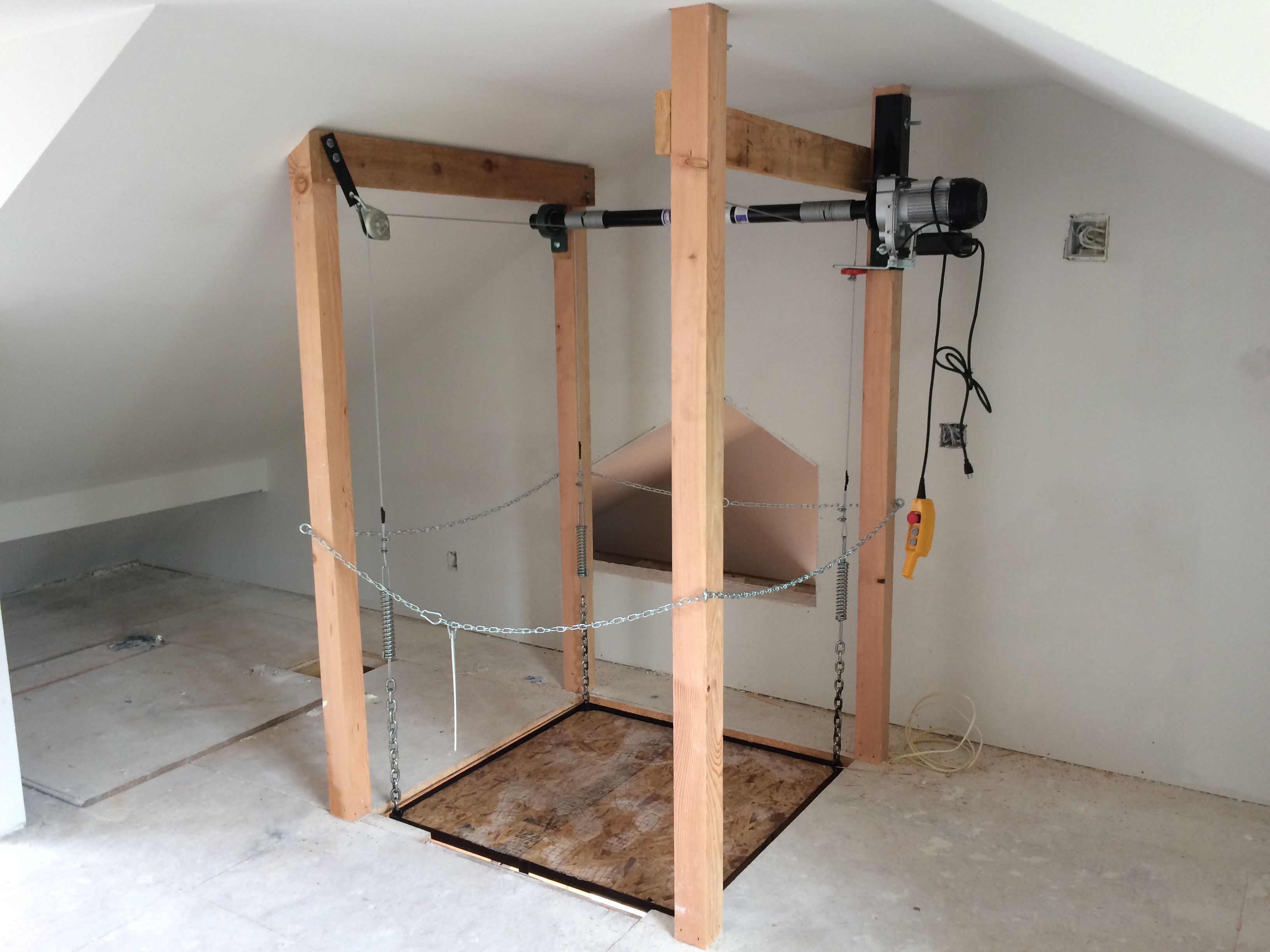 903 705 5600 The Attic Lift Utilize Your Attic Space For More Efficient Storage Instead Of Just Junk With Our Attic Lift Garage Lift Garage Ceiling Storage