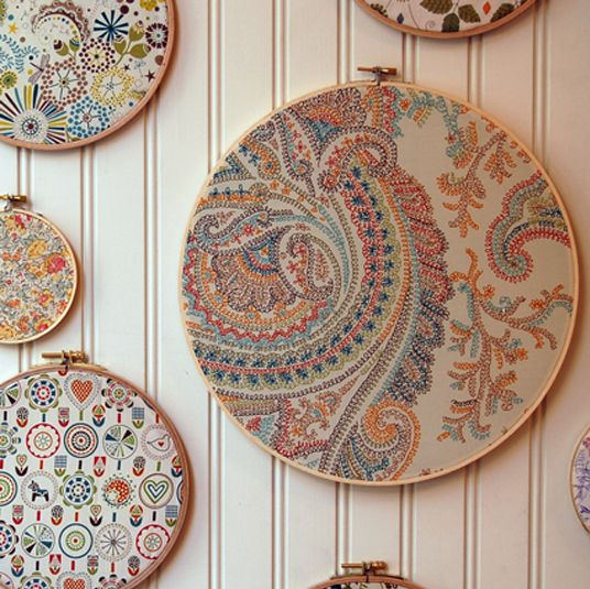 What a great idea. paisley prints framed in embroidery hoops.