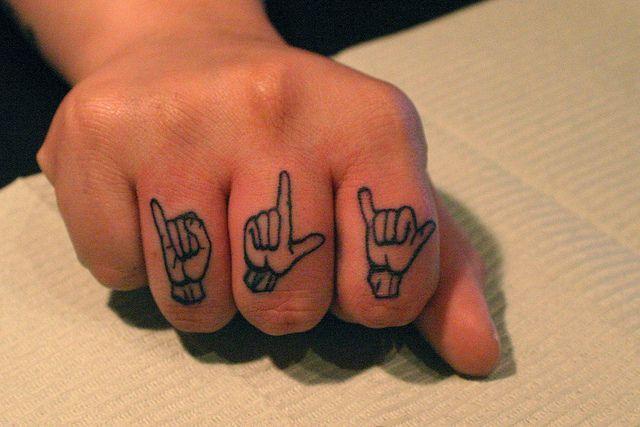 I love you sign language tattoo    I tattoo @Joshua Hansen Boogaloo 528 Green St. San Francisco, CA 94133 (415) 391-1053