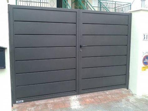 Puerta con 2 láminas de cierres metálicos avila, s.l. moderno | homify