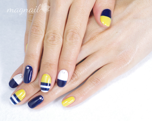 navy blue yellow and white nails