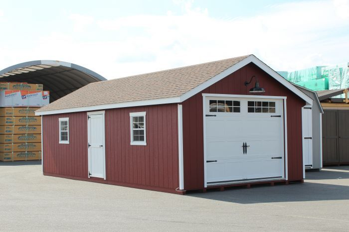 14 X28 Painted Garden Shed Garage With Heritage Overhead Door And Sconce Light Shed Backyard Barn Backyard Structures