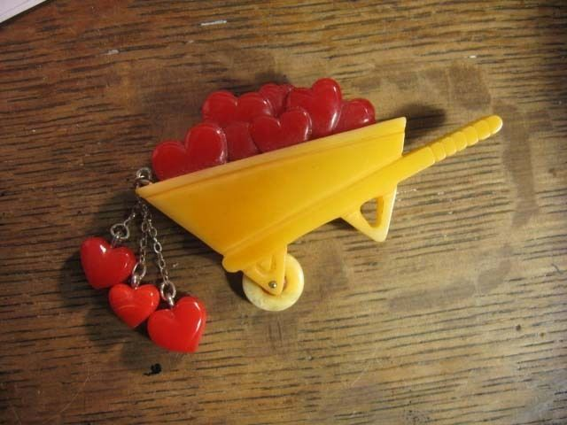 Carved Bakelite Valentine's Day Wheel Barrow Full of Hearts Pin Catalin Elfrink (newly carved from vintage bakelite)