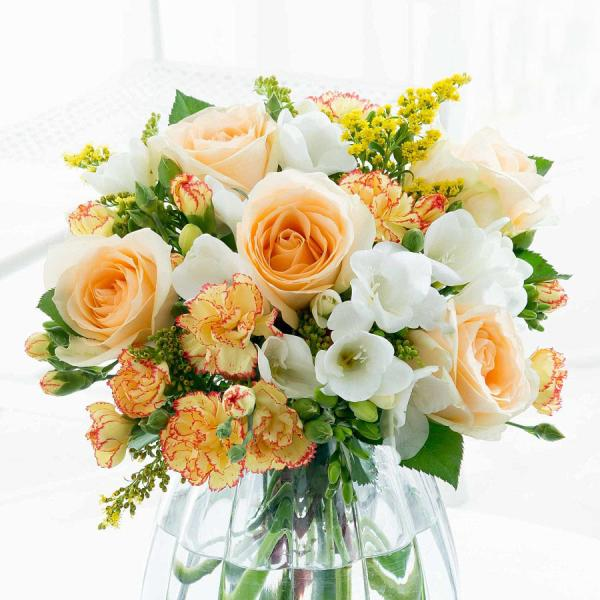 Sweetly Scented Freesias Are Impeccably Combined With Orange Roses And Textural Solidago In This Ornate Bouquet Flowers Uk Flower Delivery Uk Flower Delivery