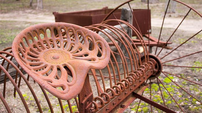 A cast iron seat, whose craftsmanship John Spunner admires. (Photo: ABC Gippsland/Zoe Ferguson)