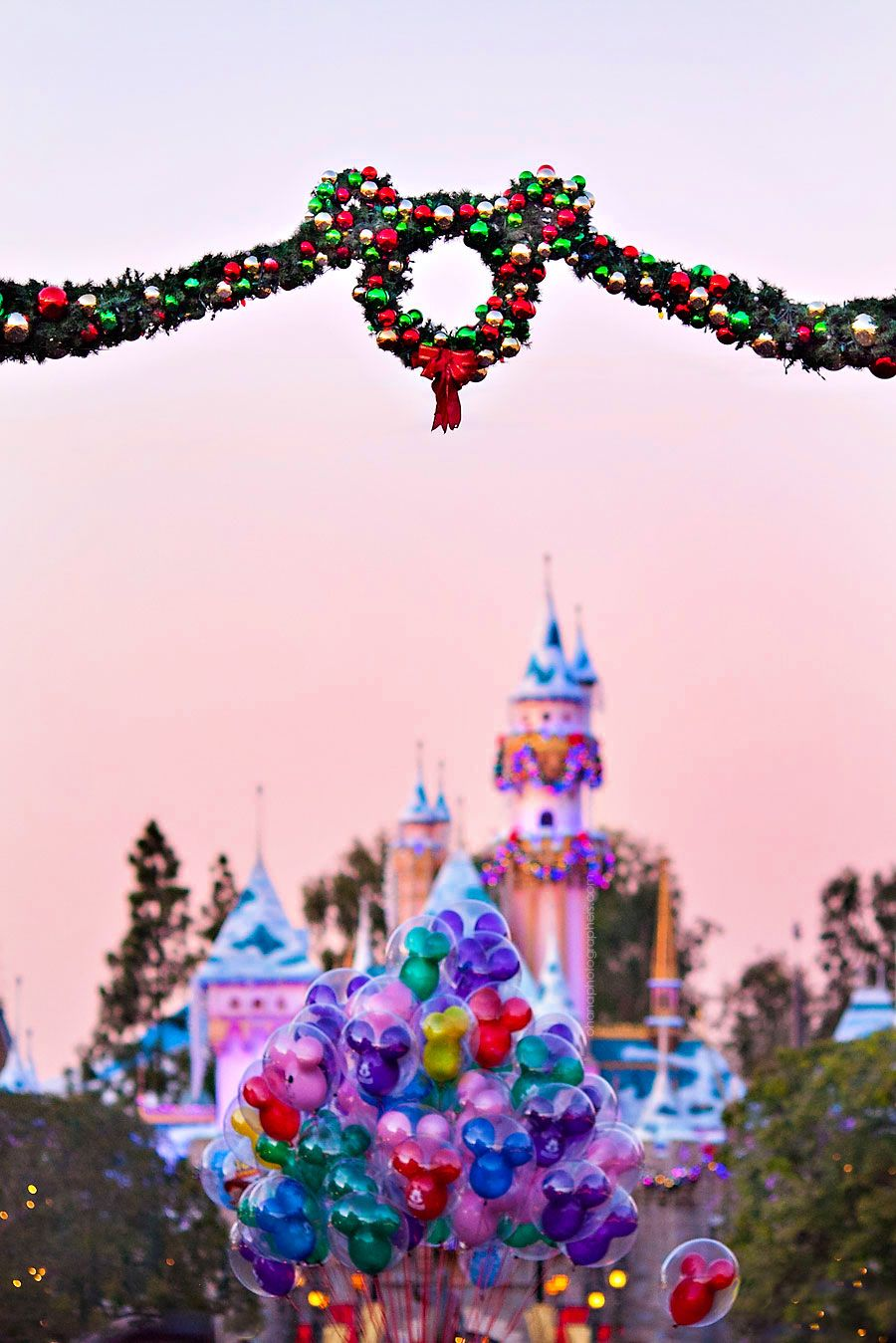 Disneyland Sleeping Beauty Castle at Christmas // Mickey Mouse Balloons // view from Main Street U.S.A