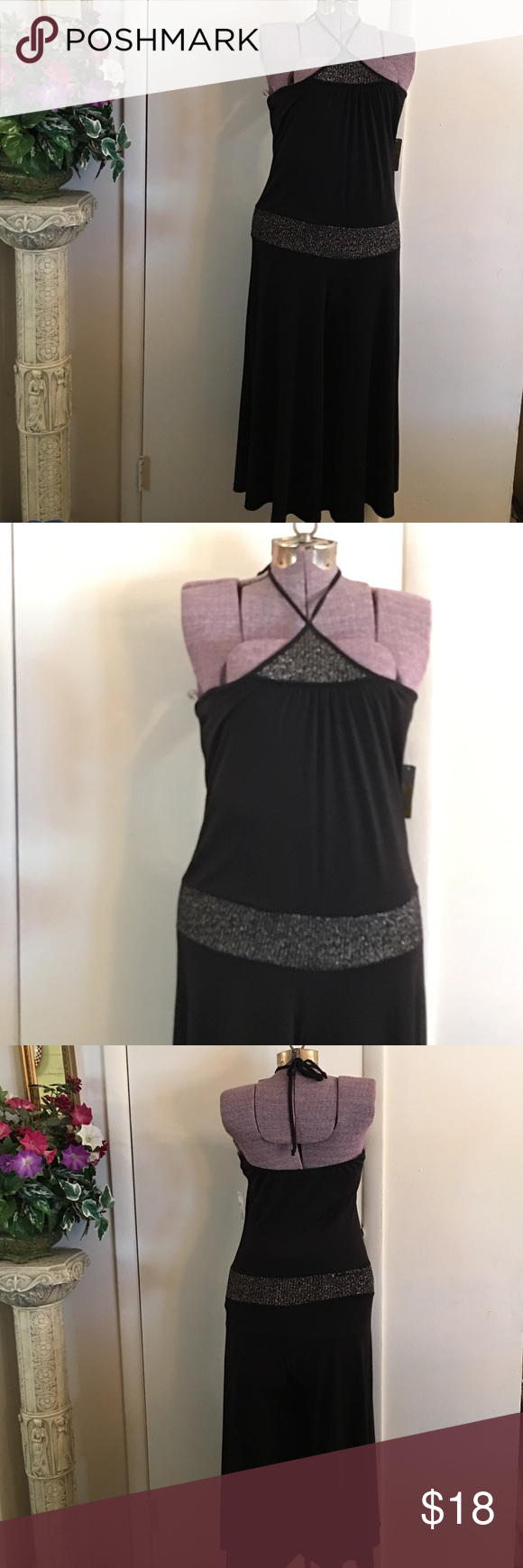 New Black Halter Jumpsuit  New Black halter jumpsuit, halter tie around the neck in back,  silver shimmery contrast, below knee length, 45% polyester 45% rayon 10% spandex, (silver thread snag on last pic) won't notice while wearing Twenty one Pants Jumpsuits & Rompers